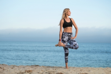 Gabby-Reece_Fitbit-Surge_Tangerine_Stretching (1)